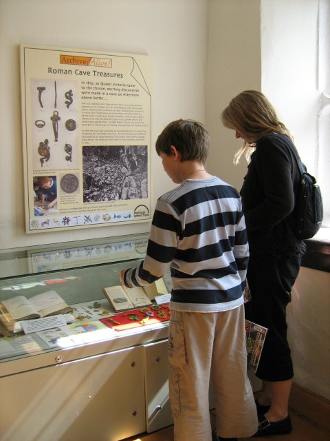 Display about the Roman brooches found in Victoria Cave, Settle and recreated by Horton-in-Ribblesdale School. (JPG, 56Kb)