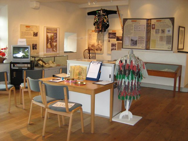 Top floor of the museum with exhibits about morris dancing and other creative arts in Craven (JPG, 56Kb)