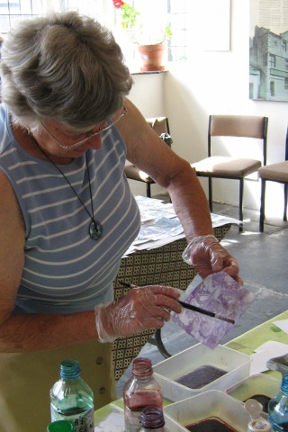 Visitors have a go at a domestic version of marbling using cooking oil, washing up liquid and inks (JPG, 60Kb)
