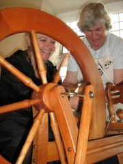 A visitor braves the spinning wheel with expert advice (JPG, 45Kb)
